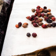Stock Photo: Dried briar or berry Rose hips on vintage wooden background