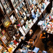 PORTO, PORTUGAL - APRIL, 4: Customers shop for books in old european bookstore Livraria Lello on April 4, 2011 in Porto, Portugal — Stock Photo