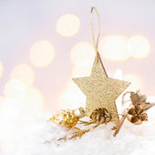 Christmas card with golden star and decorations — Stock Photo