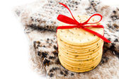 Christmas cookies with red ribbon and knitted winter mitten — Stock Photo