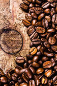 Coffee beans on grunge old wooden background. — Stock Photo