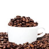 Coffee cup with beans closeup. — Stock Photo