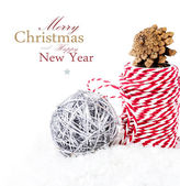 Bright Christmas composition with ribbon decorations and snow — Stock Photo