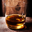 Whiskey Scotch in a glass and a bottle  — Stock Photo