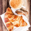 Breakfast with French Croissants and Coffee — Stock Photo #33898595