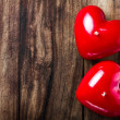 Stock Photo: Valentines Day background with two Red Hearts