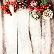 Rustic Christmas decoration on natural wooden board texture — Stok fotoğraf