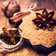Cinnamon sticks and star anise on brown sugar macro. — Stock Photo