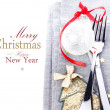 Christmas card with Festive table place setting and christmas decoratins — Stock Photo #35171785