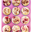 Muffins with Chocolade and Cherry in a pink colored baking tray  — Stock Photo
