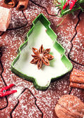 Gingerbread baking dough, cookie cutters, spices and nuts. — Stock Photo