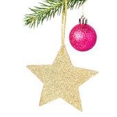 Kerstmis glanzende gouden ster op fir takken — Stockfoto