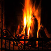 Home Fire burning in brick fireplace. — Stock Photo