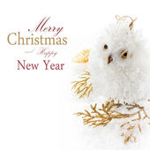 Christmas owl and decoration on a white snow — Stock Photo