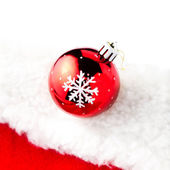 Christmas bauble on white and red background — Stock Photo