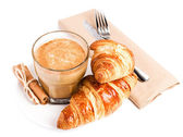 Coffee with milk and Croissants on white plate and linen napkin — Stock Photo