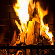 Stock Photo: Home Fire burning in fireplace.
