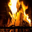 Stock Photo: Home Fire burning in the fireplace.