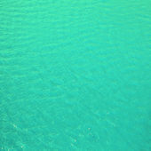 Bright cyan blue sea water may use as background or texture. — Stock Photo