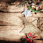 Vintage Christmas Decoration on natural wooden textured background — Zdjęcie stockowe