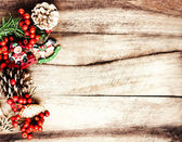 Vintage Christmas Decoration on natural wooden textured background — Stock Photo