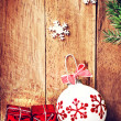 Red gift box and white ball — Stock Photo