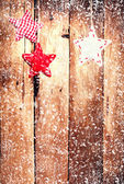 Red ornaments and falling snow — Stock fotografie