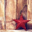 Christmas background with red star and snowflakes — Stock Photo #38706285