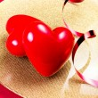 Stock Photo: Two Red Hearts on golden plate