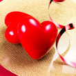 Two Red Hearts on golden plate — Stock Photo