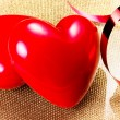 Two Red Hearts on golden plate close up — Stock Photo