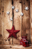 Christmas background with red star and snowflakes — Stock Photo