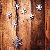 Christmas background with festive ornaments and snowflakes — Stock Photo