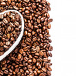 Roasted Coffee Beans in a white Heart shaped box — Stock Photo