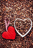 Roasted Coffee Beans with Red Heart over coffee beans background — Stock fotografie
