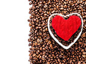 Roasted Coffee Beans with Red Heart over coffee beans background — Stock Photo