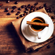 Stock Photo: Coffee cup and roasted coffee beans  on wooden