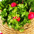 A bunch of fresh vegetables in a bowl wicker basket — Stock Photo #41448175