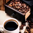 Stock Photo: Cup of coffee with coffee beans and Coffee grinder