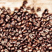 Roasted Coffee Beans background texture on wooden background — Stock Photo