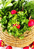 A bunch of fresh vegetables in a bowl wicker basket — Stock Photo
