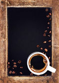 Coffee cup and vintage slate — Stock Photo