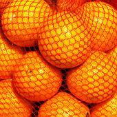 Orange fruits in a string bag — Stock Photo