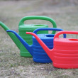 Set of watering cans in the garden — Stock Photo