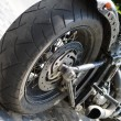 Motorcycle tire and exhaust close up — Stock Photo