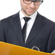 Young businessman with file binder — Stock Photo #30006303
