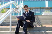 Young businessman outdoors — Stock Photo