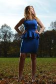 Pretty young woman in blue dress — Stock Photo