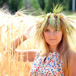 The girl on a field with wheat ears — Stock Photo