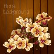 Beautiful flowers on a wooden texture. — Stock Vector #29859045